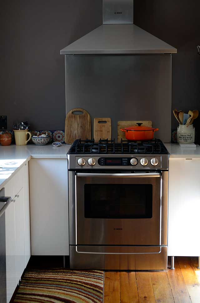 Stove and stainless steel backsplash